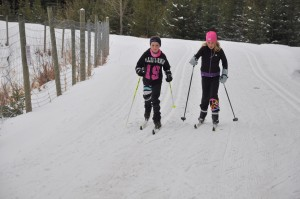 Abby and Michelle skiing at Silver Star Camp